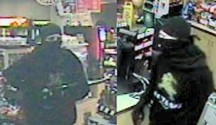 The male was wearing all black and had his face covered, except for eyes, with a black bandana.