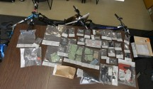 The search resulted in the seizure of a large quantity of narcotics, multiple registration and insurance cards, bicycles, and cash.