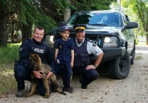 (l-r) Cst. Kevin Challoner and Hector with Jackson Antoniw and S/Sgt Matt Lavallee at Rossburn Elementary School on June 18, 2015.
