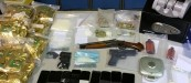$94,000 in seized drugs, firearms and paraphernalia. (EPS)