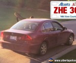 The male left in a stolen red or maroon Acura 4 door with Alberta Licence plate ZHE360 which was stolen out of Airdrie.
